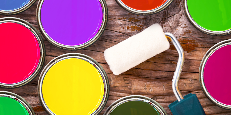Colorful paint tins and a roller