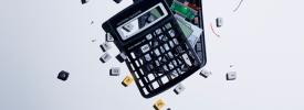 Calculator smashing into pieces