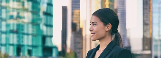 Asian business woman smiling profile portrait successful career young leader in city background panoramic banner.